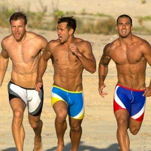 three men running on beach